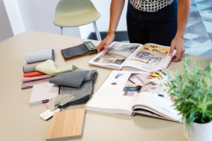 An Interaction office furniture consultant with colour samples and fabric swatches designing bespoke office furniture.