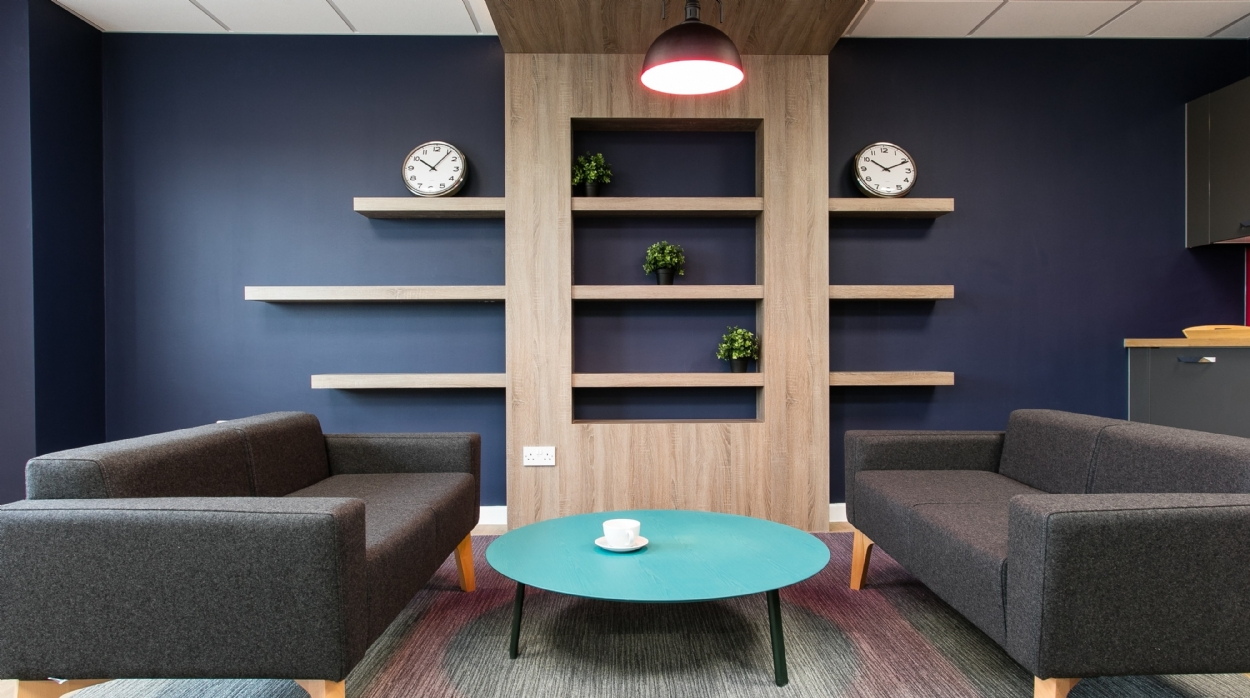New informal meeting area with sofas and coffee table