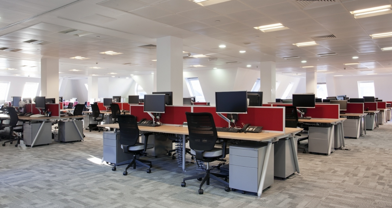 Open plan office with large number of desk cubicles in a newly refurbished London law office